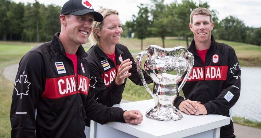 Members of the Canadian Olympic golf team Graham DeLaet, left, Alena Sharp and David Hearn pose with the 1904 Olympic golf trophy in Oakville, Ont., on July 17, 2016, as the Canadian Olympic Committee and Golf Canada announce the players to represent Team Canada at this year's Rio Olympics. (Chris Young/THE CANADIAN PRESS)