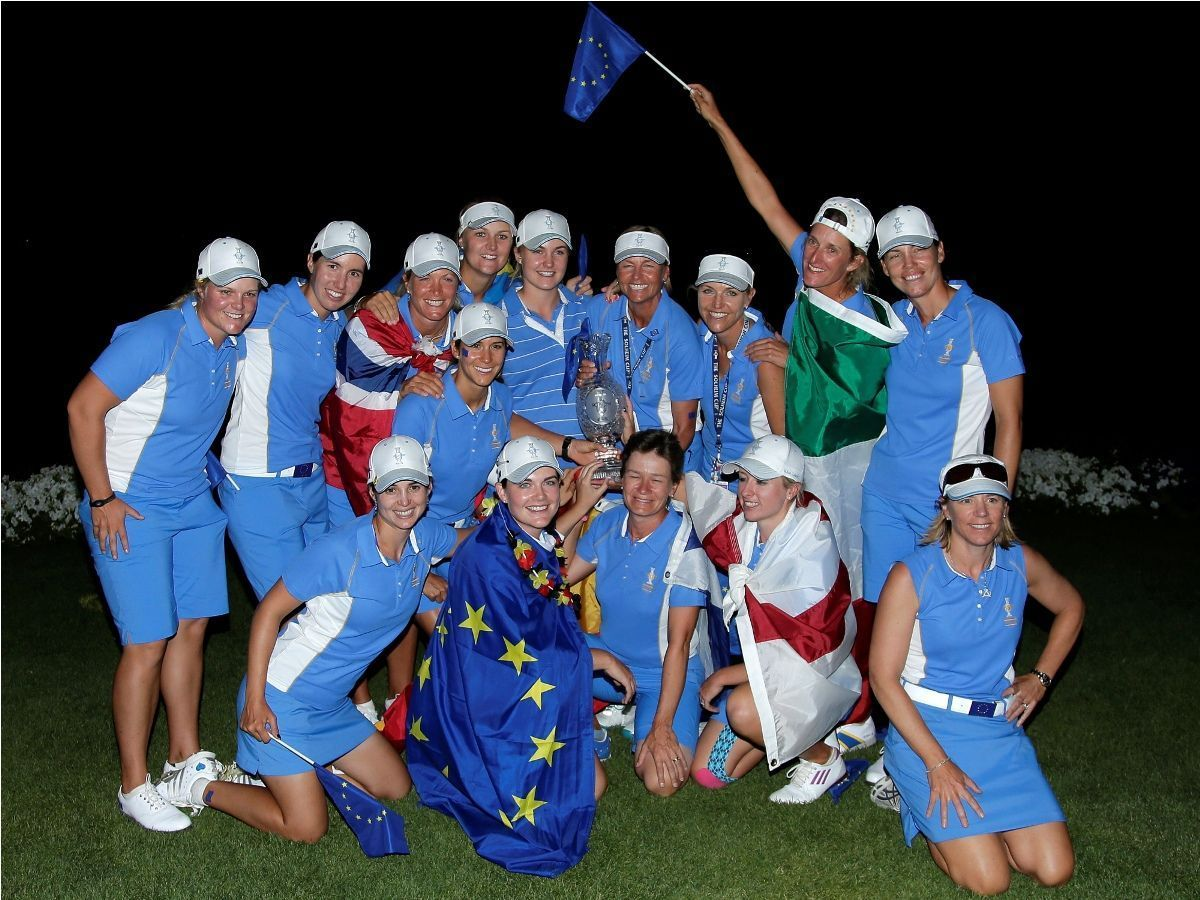 Members of team Europe pose for group picture after winning the Solheim Cup golf tournament, Sunday, Aug. 18, 2013, in Parker, Colo. (AP Photo/Chris Carlson)