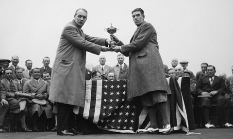 George Duncan (right), captain of the British Ryder Cup team, is presented with the Ryder Cup by British businessman Samuel Ryder at the 1929 Matches. (Getty Images)